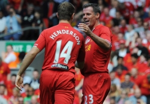 Henderson celebrates with Jamie Carragher as Henderson scores Liverpool's second
