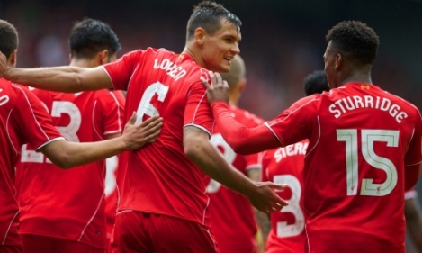 Lovren celebrates scoring on debut